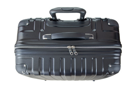 lightweight: Top view of a big lightweight hard shelled suitcase, new and clean luggage in black color made of Polycarbonate material isolated on white background