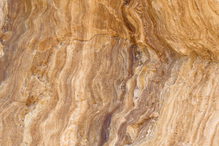 mot: Closeup abstract background texture photo of yellow layer crystalline limestone with natural stripe pattern