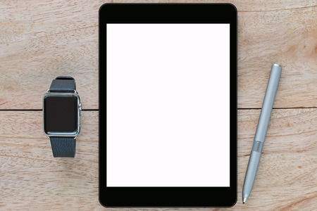 stylus pen: Smart watch with leather bands, black tablet computer with white blank screen and thin-tip stylus pen on wooden background Stock Photo