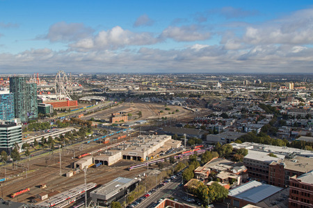 bombardier: MELBOURNE, AUSTRALIA - APRIL, 2016 : Bird view of  West Melbourne with Bombardier tram depot and Star Observation Wheel in the foreground in Melbourne, Australia on April 11, 2016 Editorial