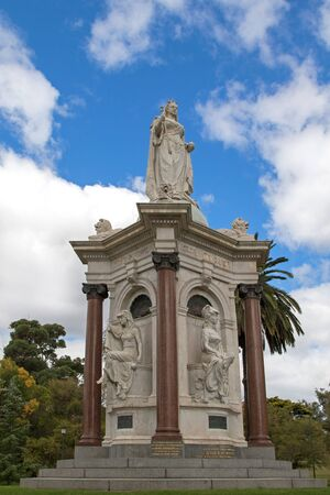 queen victoria: MELBOURNE, AUSTRALIA - APRIL, 2016 : Granite and marble statue of the Queen Victoria Memorial located in the Queen Victoria Gardens against blue sky with clouds in Melbourne, Australia on April 10, 2016. It was created by sculptor James White Editorial