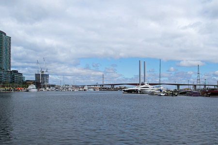 docklands: MELBOURNE, AUSTRALIA - APRIL, 2016 : View of the Bolte Bridge from the Melbourne Docklands in Melbourne, Victoria Harbour in Australia on April 10, 2016. It is a large twin Cantilever bridge in Melbourne.