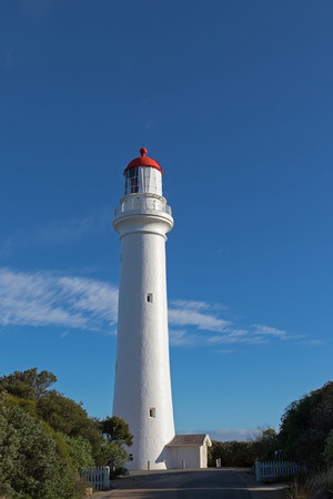 split road: Split Point Lighthouse in Aireys Inlet, on the Great Ocean Road. Famous tourist attraction in Victoria, Australia