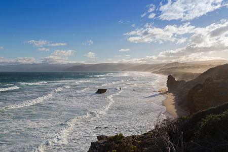 split road: Coastal landscape of the ocean in the afternoon. View from Split Point Lighthouse in Aireys Inlet, on the Great Ocean Road. Famous tourist attraction in Victoria, Australia Stock Photo