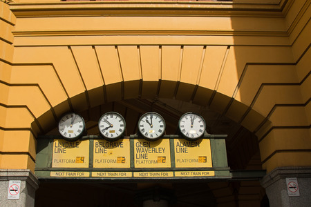 flinders: MELBOURNE, AUSTRALIA - APRIL, 2016 : Closeup view of station clocks at the main entrance of Flinders Street Railway Station in Melbourne Victoria, Australia on April 10, 2016. Flinders Street railway station serves the entire metropolitan rail network Editorial