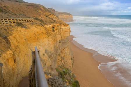 gibson: Partial view of 86 step wooden staircase beach access at Gibson Steps down the cliff to the seashore in Port Campbell National Park on the Great Ocean Road in Victoria, Australia Stock Photo
