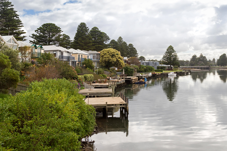Beautiful modern waterfront houses with personal docks along the Moyne River in Port Fairy, Victoria, Australia.