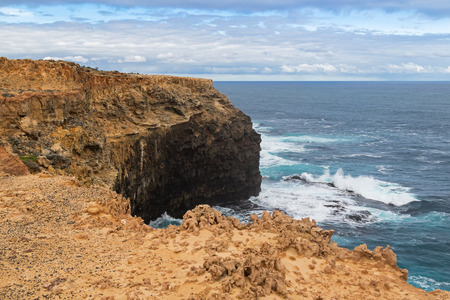 stoney: Landscape view of coastal cliff at Petrified Forest Walk with deep blue sea water splashing at Cape Bridgewater in Victoria, Australia