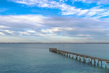 Robe: Evening view of Robe Jetty with blue sky and clouds in Robe, South Australia Stock Photo