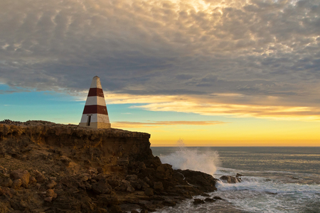stoney: View of waves splashing rock at Obelisk, a historic landmark at Cape Dombey during sunset in Robe, South Australia