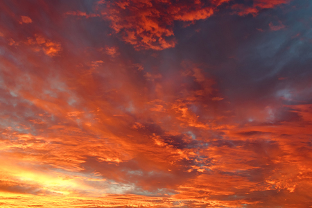sunset clouds: Background photo of dark blue sky in the evening with golden yellow orange shade of the sunset. Beautiful and natural clouds formation.