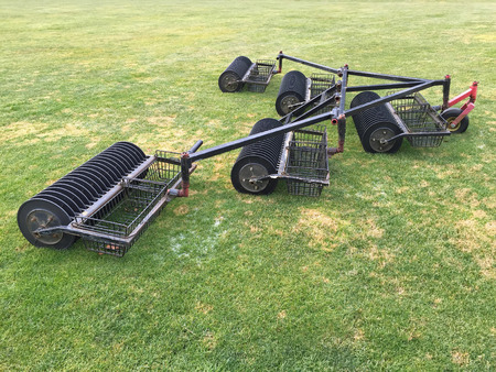 outside machines: Ball picker cart to pick up Golf balls at driving range, summer in Europe Stock Photo
