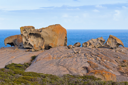 Remarkable Rocks, natural rock formation covered by golden orange lichen at Flinders Chase National Park. One of Kangaroo Islands iconic landmarks, South Australia