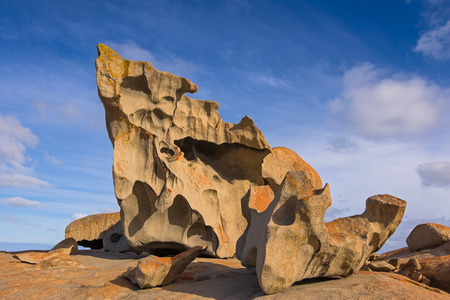 chase: Remarkable Rocks, natural rock formation covered by golden orange lichen at Flinders Chase National Park. One of Kangaroo Islands iconic landmarks, South Australia