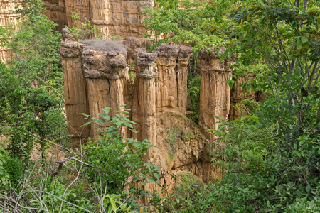 deposition: Soil Columns with 30 meter height called The Roman caused by deposition of sediment in late Tertiary Period at Pha Chau, Pha Chor Canyon, Mae Wong National park, Chiang Mai, Thailand Stock Photo