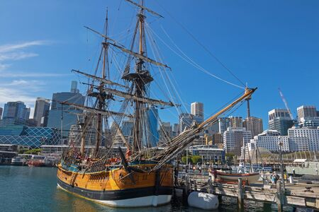 tall ship: SYDNEY, AUSTRALIA - APRIL, 2016 : View of Tall Ship HMB Endeavour mooring in front of the Australian National Maritime Museum, Darling Harbour in Sydney, Australia on April 21, 2016.