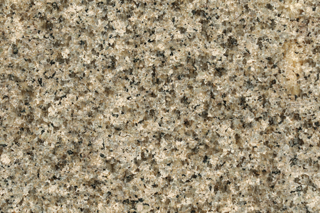 polished granite: Closeup texture of polished granite rock in gray black. Abstract background photo of natural stone pattern Stock Photo