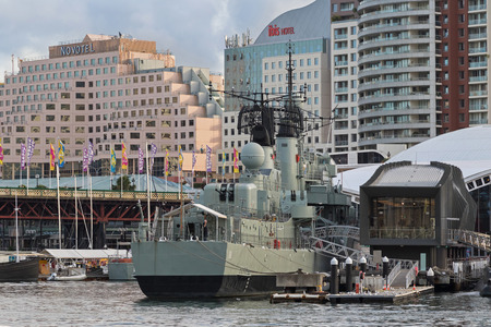 darling: SYDNEY, AUSTRALIA - APRIL, 2016 : Australian Daring-class destroyer HMAS Vampire and other ships docking at Darling Harbour with Pyrmont Bridge in background, Sydney, Australia on April 21, 2016. Editorial