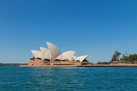 the world heritage: SYDNEY, AUSTRALIA - APRIL, 2016 : Famous Sydney Opera House, view from Overseas Passenger Terminal in Sydney, Australia on April 20, 2016. It is a famous arts center, one of UNESCO World Heritage sites