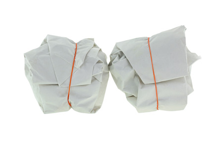 rubberband: Takeout Thai Food wrapped in white paper package with red rubber band for takeaway, isolated on white background