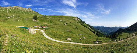 pp: Panoramic view of Kafell peak and other peaks during summer time near Jenbach, Tyrol, Austria. Panorama of view from Hochplatte mountain peak at 1,813 m. Kafell ranks as the 1106th highest mountain in Achenkirch in Tyrol, Austria