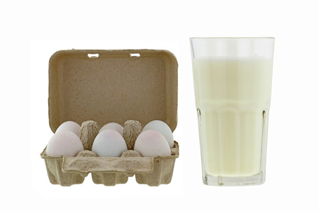 pasteurized: Paper pulp egg tray packages of fresh eggs next to glass of fresh pasteurized milk isolated on white background