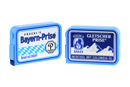 snuff: BAVARIA, GERMANY - JUNE, 2015 : Boxes of Poschl Gletscher Prise, a nasal snuff in Bavaria, Germany on June 26, 2015. Snuff is smokeless tobacco with Brazil flavor and mint flavor, Colombian menthol oil. Editorial