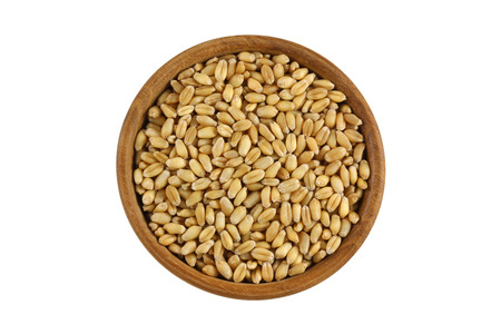 wheat kernel: Top view of dried Wheat Berries in wooden bowl. Dry wheat berry isolated on white background.