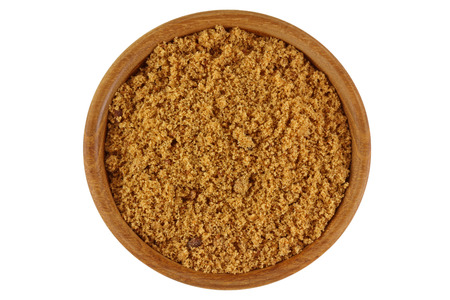 unrefined: Top view of unrefined unbleached natural Brown sugar in brown color in a wooden bowl isolated on white background