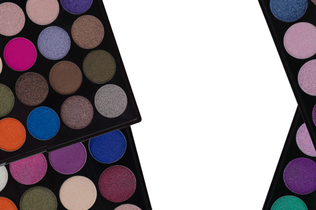 closeup view: Colorful Eyeshadow. Closeup top view of makeup cosmetic palette isolated on white background with center copyspace Stock Photo