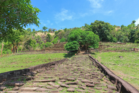 stoney: Stoney walkway and staircase leading to upper level of rained Vat Phou (Wat Phu)  Khmer Hindu temple complex and UNESCO World Heritage Site in Champasak Province, southern Laos Stock Photo