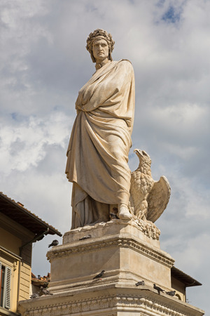 Statue of Durante degli Alighieri, also called Dante and eagle in the Piazza di Santa Croce in Florence, Italy. Dante is Italian poet of the late Middle Ages