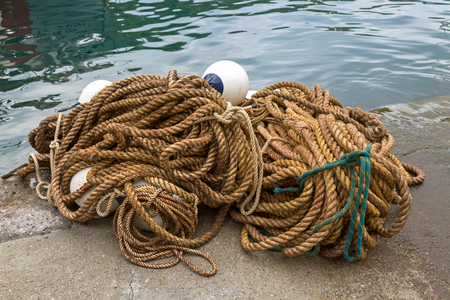 sea fishing: Big pile of ropes with floats to tie boats and used in fishing industry by Mediterranean Sea in Italy, southern Europe Stock Photo