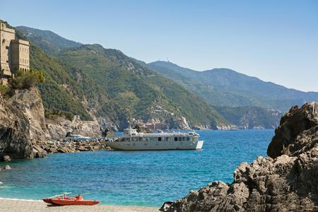 commune: Tourist passengers getting off ferry ship at Monterosso al Mare, commune town in La Spezia province, Liguria region, Northern Italy