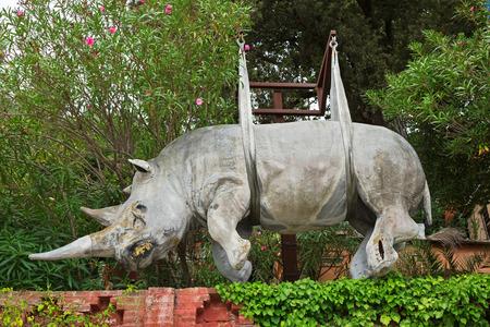 suspend: LIGURIA, ITALY - SEPTEMBER 2016 : Status of suspended rhinoceros rhino sculpture hanging above the Marina di Portofino in Portofino, Liguria, Italy Northern Europe on September 23, 2016. Editorial