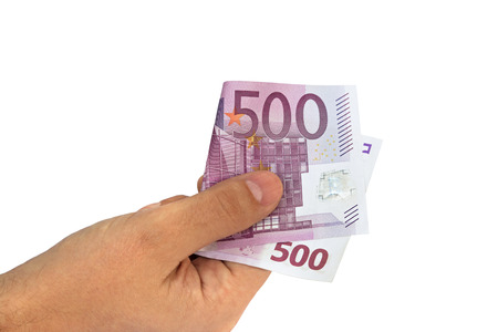 euro bill: Man?s hand holding five hundred 500 Euro banknote money bill isolated on white background