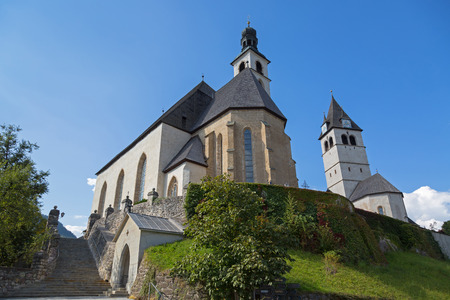 in low spirits: KITZBUEHEL, AUSTRIA - SEPTEMBER 2016 : Low angle view of Pfarrkirche St. Andreas and Church of Our Lady (Liebfrauenkirche), cemetery on hill in Kitzbuhel, Austria on September 27, 2016