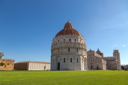 st john: PISA, ITALY - SEPTEMBER 2016 : Pisa Baptistery of St. John (Battistero di San Giovanni), Roman Catholic ecclesiastical building with Pisa, leaning tower in background in Pisa, Italy on September 22, 2016.