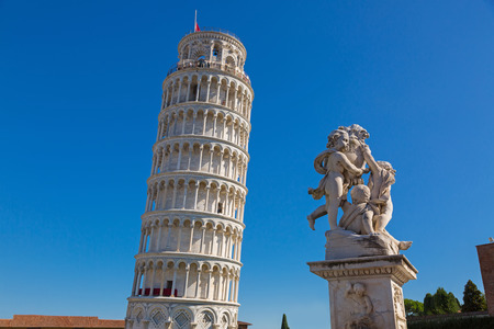 PISA, ITALY - SEPTEMBER 2016 : World famous Leaning Tower of Pisa and status of cherubs winged angels in Pisa, Italy on September 22, 2016. Pisa Tower (Torre pendente di Pisa) is a freestanding bell tower campanile of cathedral Editorial