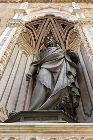 detai: FLORENCE, ITALY - SEPTEMBER 2016 : Bronze statue of St. John the Baptist, detail of Orsanmichele church exterior with 1of 14 external niche figures in Florence, Italy on September 21, 2016. Editorial