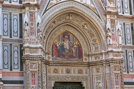 FLORENCE, ITALY - SEPTEMBER 2016 : Details of Jesus holding globe mosaic, Christ Pantocrator, Christian iconography, on west Almond door portal of Florence Cathedral, Porta della Mandorla in Florence, Italy on September 21, 2016