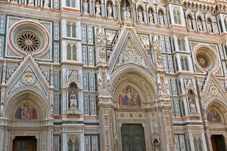 iconography: FLORENCE, ITALY - SEPTEMBER 2016 : Details of Jesus mosaic, Christ Pantocrator, Christian iconography, on Almond door portal of Florence Cathedral, Porta della Mandorla in Florence, Italy on September 21, 2016. Editorial
