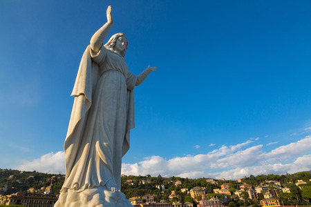 sea of houses: SANTA MARGHERITA LIGURE, ITALY - SEPTEMBER 2016 : Statue of Santa Margherita facing the sea with background view of hotels restaurants houses at Tigullio Gulf of Santa Margherita Ligure, Italy on September 22, 2016. She prays for safe return of fishermen Editorial