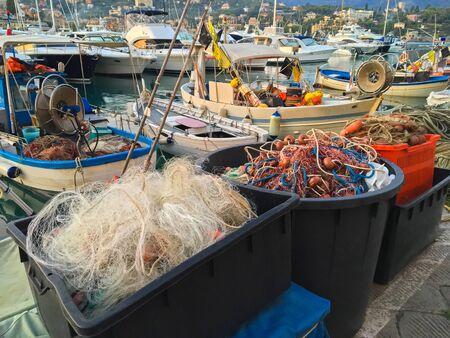 fishingnet: Plastic box full of fishing net, floats, nylon rope used in fishing industry in evening at Tigullio Gulf of Santa Margherita Ligure, Italy