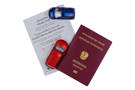 motor cars: BANGKOK, THAILAND - OCTOBER 2016 : Mini cars, Austrian passport on International Driving Permit, motor traffic issued in Bangkok, Thailand on October 23, 2016 isolated on white background