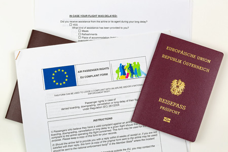 complain: MUNICH, GERMANY - OCTOBER 2016 : Austrian electronic passport on EU complaint form at Munich airport, Germany on October 23, 2016. Passengers can complain against airline concerned with denied boarding, downgrading, cancellation, delay.