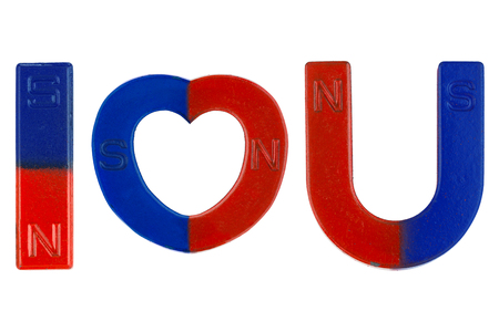 Magnets in red blue with word I Love You ( letter alphabet I heart U) isolated on white background. Conceptual for love attraction