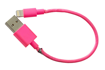 Closeup of broken smart phone charger pink USB cable isolated on white background