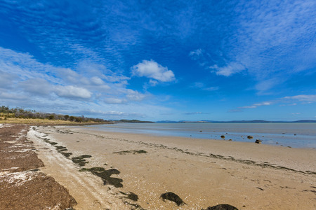 frederic: Peaceful afternoon at Dunalley Beach, Frederic Henry Bay, east coast of Tasmania, along Arthur highway, Australia Stock Photo