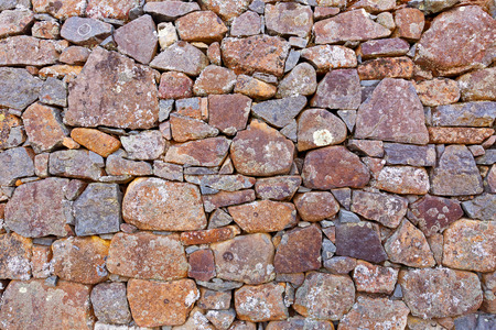 geological formation: Background texture of lichen covering stone wall made of rocks, photo of slow growing fungus on wall  Stock Photo